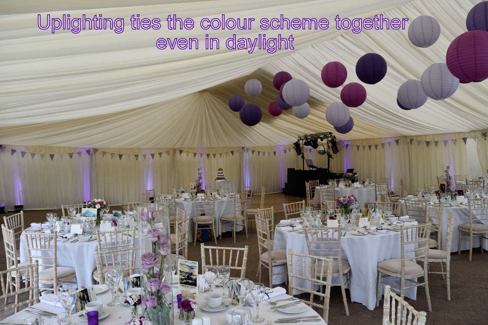 Uplighting ties the wedding colour scheme together in a marquee